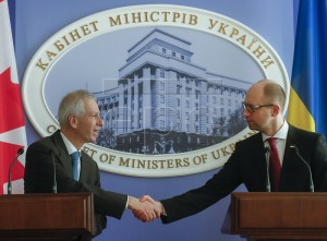 epa05138337 Ukraine's Prime Minister Arseniy Yatsenyuk (R) and Canadian Foreign Minister Stephane Dion shake hands during a press conference in Kiev, Ukraine, 01 February 2016. Stephane Dion arrived in Ukraine on his first working visit after the forming of a new government in Canada.  EPA/SERGEY DOLZHENKO